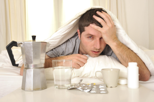 Copy of exhausted-young-man-bed-coffee-water-171835346